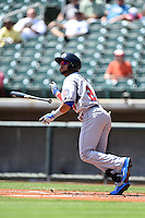 Tennessee Smokies outfielder Rubi Silva (24) hits a home run during a game against the Birmingham Barons on April 21, 2014 at Regions Field in Birmingham, Alabama.  Tennessee defeated Birmingham 10-5.  (Mike Janes/Four Seam Images)
