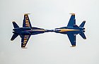 The #5 and #6 jets in the demonstration are called the 'opposing solos.' While the 4-jet diamond formation is away from air show center the solos perform other maneuvers to show the capabilities of the jets and pilots such as this head on pass.<br /> <br /> Photo by Matt Cashore/University of Notre Dame