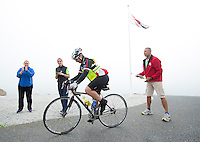 26 SEP 2013 - LANDS END, GBR - Judith Martin starts the bike for the Enduroman 2013 Lands End to London to Dover ultra triathlon at Lands End, Sennen, Cornwall, Great Britain watched by Kat Hanigan (left), Louise Dutch (second left) one of her support crew and, race director Edgar Ette (right) (PHOTO COPYRIGHT © 2013 NIGEL FARROW, ALL RIGHTS RESERVED)
