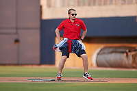 """Kannapolis Cannon Ballers General Manager Matt Millward dances as part of the """"Ballerinas"""" between innings of the game against the Charleston RiverDogs at Atrium Health Ballpark on July 4, 2021 in Kannapolis, North Carolina. (Brian Westerholt/Four Seam Images)"""