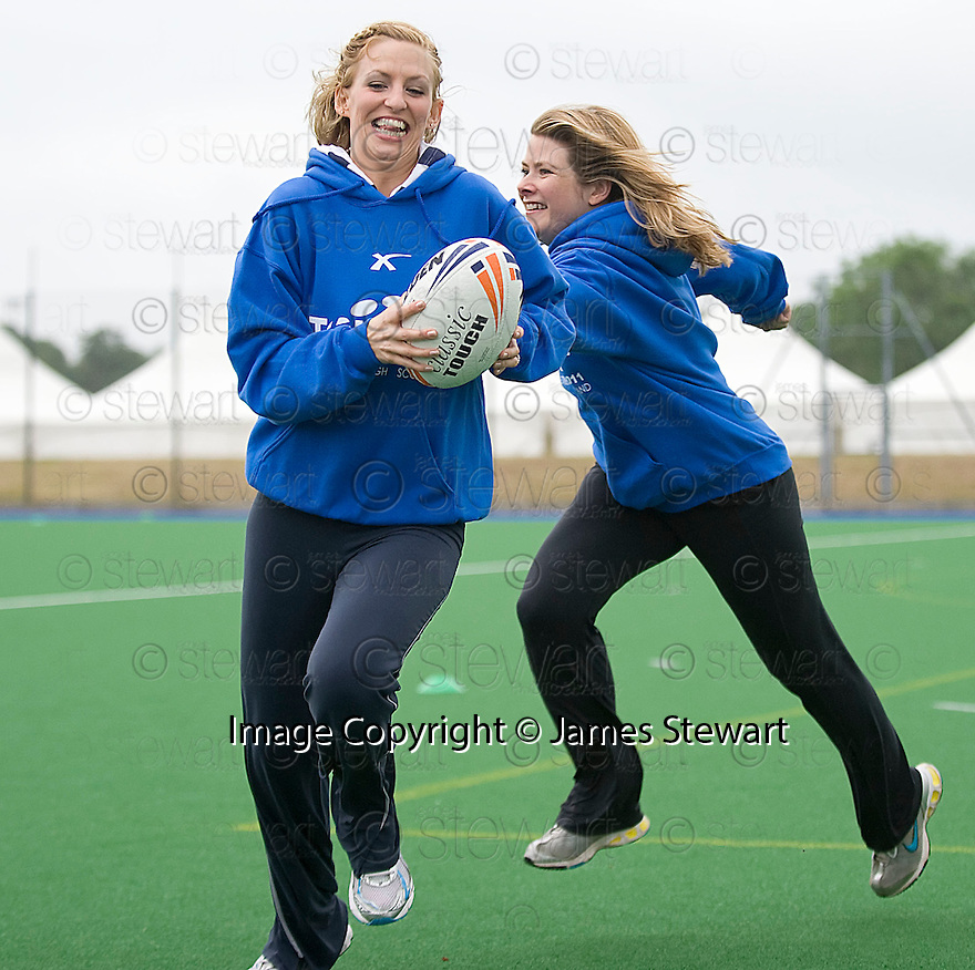 TEACHERS FROM CORSTORPHINE PRIMARY SHOW THE PUPILS HOW IT SHOULD BE DONE AS THEY TAKE PART IN THE TOUCH WORLD CUP YOUTH FESTIVAL AT PEFFERMILL.