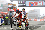 Cadel Evans thanks his teammate Marcus Burghardt (BMC)as they cross the line at the finish summit of the Col du Tourmalet during a wet foggy Stage 17 of the 2010 Tour de France at Palais Beaumont from Pau to Col du Tourmalet, 22nd July 2010 (Photo by Steven Franzoni/NEWSFILE)