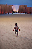 A little indigenous boy walks determinedly in the Green Arena during the International Indigenous Games, in the city of Palmas, Tocantins State, Brazil. Photo © Sue Cunningham, pictures@scphotographic.com 26th October 2015