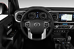 Car pictures of steering wheel view of a 2016 Toyota Tacoma TRD Off Road Double 4 Door Pick Up