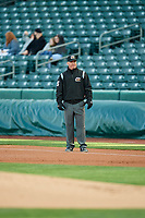 Umpire Ryan Blakeney handles the calls on the bases during the game between the Salt Lake Bees and the Sacramento River Cats at Smith's Ballpark on April 12, 2019 in Salt Lake City, Utah. The River Cats defeated the Bees 4-2. (Stephen Smith/Four Seam Images)