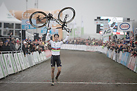 Wout van Aert (BEL/VerandasWillems-Crelan) walking over the finish line holding his new bike sponsor high as he becomes Belgian National Elite Cyclocross Champion for a 2nd time in a row<br /> <br /> Elite Men's Race<br /> National CX Championships 2017