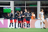 FOXOBOROUGH, MA - AUGUST 21: New England Revolution celebrate the goal of Adam Buksa #9 of New England Revolution of an assist by Emmanuel Boateng #11 of New England Revolution during a game between FC Cincinnati and New England Revolution at Gillette Stadium on August 21, 2021 in Foxoborough, Massachusetts.