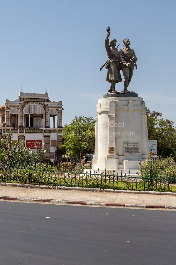 Dakar, Senegal.  Place du Tirailleur, with Statue to Demba and Dupont, Heroes of World War I.  Dakar Train Station in background.