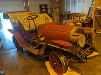 BNPS.co.uk (01202 558833)<br /> Pic: Beaulieu/BNPS<br /> <br /> Pictured: Mr Toad's car as it was found.<br /> <br /> Mr Toad's car from Wind in the Willows has gone on display after a painstaking restoration following years of neglect.<br /> <br /> The vehicle was made for the 1996 film adaptation of Kenneth Grahame's classic 1908 children's book starring Terry Jones as the obsessive amphibian.<br /> <br /> The car, which appears to be from the Edwardian era, was actually built in 1995 at Shepperton Studios for the film.<br /> <br /> Following the film's release, it was transported to America, where it spent many years hanging from the ceiling of a Florida restaurant.<br /> <br /> It was brought back to Britain last year in a dilapidated state and has been restored at the National Motor Museum workshop in Beaulieu, Hants, where visitors can see it driven around the grounds.