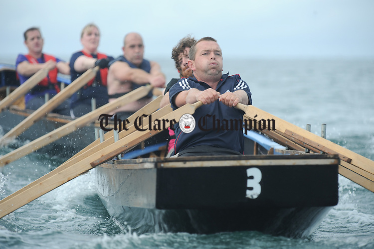 Competitors feel the pain as they take part in the Currach racing as part of the Kilkee Maritime Festival. Photograph by John Kelly.