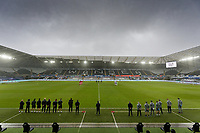 Both teams, match officials and clubs staff observe a minute's silence prior to the Sky Bet Championship between Swansea City and Rotherham at the Liberty Stadium, Swansea, Wales, UK. Saturday 21 November 2020