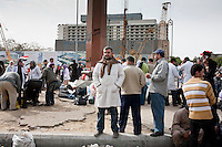 A volunteer doctor takes a break from treating injured anti government protesters in Cairo's Tahrir Square. Continued anti-government protests take place in Cairo calling for President Mubarak to stand down. After dissolving the government and allowing for talks with opposition parties Mubarak still refuses to step down from power.