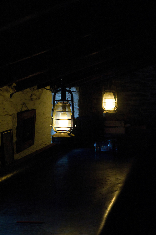 Oil lamps in potting shed, Heligan, Cornwall.