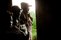 People take shelter from torrential rain storm in Chudja mine. North- eastern  DRC.