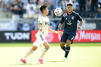 KANSAS CITY, KS - JUNE 26: Marco Farfan #32 Los Angeles FC with the ball during a game between Los Angeles FC and Sporting Kansas City at Children's Mercy Park on June 26, 2021 in Kansas City, Kansas.