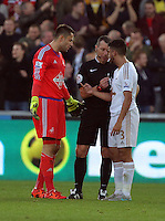 (L-R) Lukasz Fabianski of Swansea protests to match referee Kevin Friend for Koscielny's goal, who speaks to Neil Taylor of Swansea during the Barclays Premier League match between Swansea City and Arsenal at the Liberty Stadium, Swansea on October 31st 2015