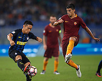 Calcio, Serie A: Roma vs Inter. Roma, stadio Olimpico, 2 ottobre 2016.<br /> FC Inter's Yuto Nagatomo, left, is challenged by Roma's Diego Perotti during the Italian Serie A football match between Roma and FC Inter at Rome's Olympic stadium, 2 October 2016.<br /> UPDATE IMAGES PRESS/Isabella Bonotto