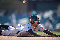 Salt River Rafters Victor Victor Mesa (10), of the Miami Marlins organization, slides into third base during the Arizona Fall League Championship Game against the Surprise Saguaros on October 26, 2019 at Salt River Fields at Talking Stick in Scottsdale, Arizona. The Rafters defeated the Saguaros 5-1. (Zachary Lucy/Four Seam Images)