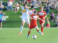 Boyds MD - April 13, 2014: Diana Matheson (8) of the Washington Spirit goes against Katherine Reynolds (16) of the Western New York Flash. The Western New York Flash defeated the Washington Spirit 3-1 in the opening game of the 2014 season of the National Women's Soccer League at the Maryland SoccerPlex.