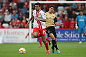 Michael Doughty of Stevenage (on loan from QPR) escapes from Lloyd James of Leyton Orient<br />  - Stevenage v Leyton Orient - Sky Bet League 1 - Lamex Stadium, Stevenage - 17th August, 2013<br />  © Kevin Coleman 2013