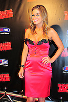 """CARMEN ELECTRA .Italian Film Premiere for """"Disaster Movie"""" in Rome, Italy, October 8th 2008..half length pink dress black trim ruffle buttons strapless hand on hip.CAP/CAV.©Luca Cavallari/Capital Pictures"""