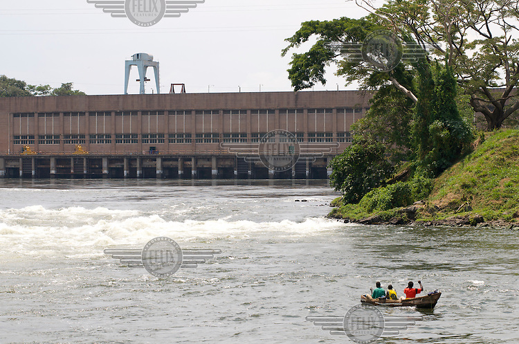 Fishermen on the River Nile below the Owen Falls Hydroelectric dam (Nalubaale Power Station). The dam has never produced as much power as planned and is due to be supplemented with a larger barrage downstream, but this project will flood a huge area and force many people out of their homes..