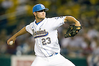 UCLA's Cody Regis runs into TCU'c Kaleb Merck at first base in Game 6 of the NCAA Division One Men's College World Series on Monday June 21st, 2010 at Johnny Rosenblatt Stadium in Omaha, Nebraska.  (Photo by Andrew Woolley / Four Seam Images)