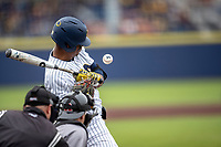 Michigan Wolverines outfielder Jordan Nwogu (42) is hit by a pitch against the Rutgers Scarlet Knights on April 27, 2019 in the NCAA baseball game at Ray Fisher Stadium in Ann Arbor, Michigan. Michigan defeated Rutgers 10-1. (Andrew Woolley/Four Seam Images)