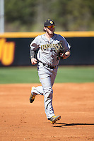 Kennesaw State Owls shortstop Kal Simmons (10) jogs off the field between innings of the game against the Winthrop Eagles at the Winthrop Ballpark on March 15, 2015 in Rock Hill, South Carolina.  The Eagles defeated the Owls 11-4.  (Brian Westerholt/Four Seam Images)