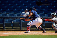 Mississippi Braves Jonathan Morales (28) lays down a sacrifice bunt in front of catcher Rodrigo Vigil (1) during a Southern League game against the Jacksonville Jumbo Shrimp on May 5, 2019 at Trustmark Park in Pearl, Mississippi.  Mississippi defeated Jacksonville 1-0 in ten innings.  (Mike Janes/Four Seam Images)