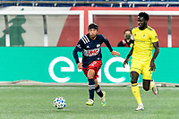 FOXBOROUGH, MA - OCTOBER 3: Lee Nguyen #42 of New England Revolution looks to pass as Derrick Jones #21 of Nashville SC defends during a game between Nashville SC and New England Revolution at Gillette Stadium on October 3, 2020 in Foxborough, Massachusetts.
