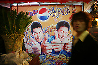 CHINA. Shanghai. An advertisement in a market. 2008