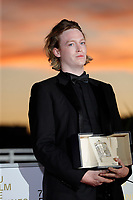 CANNES, FRANCE - JULY 17: Caleb Laundry Jones poses with the 'Best Actor Award' for 'Nitram' during the 74th annual Cannes Film Festival on July 17, 2021 in Cannes, France.<br /> CAP/GOL<br /> ©GOL/Capital Pictures