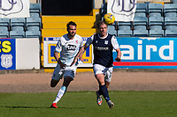 24th April 2021; Dens Park, Dundee, Scotland; Scottish Championship Football, Dundee FC versus Raith Rovers; Paul McGowan of Dundee races away from Reghan Tumilty of Raith Rovers