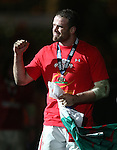 Jamie Roberts salutes the fans after Wales retain the Championship with victory over England..2013 RBS 6 Nations Championship.Wales v England.Millennium Stadium.16.03.13.Credit: Steve Pope- Sportingwales
