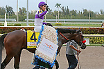 HALLANDALE BEACH, FL -APRIL 02:   #4 Nyquist (KY) with jockey Mario Qutierrez on board waves to the crowd before heading into the winner's circle after winning the Florida Derby GI on April 2nd, 2016 at Gulfstream Park in Hallandale Beach, Florida. (Photo by Liz Lamont/Eclipse Sportswire/Getty Images)
