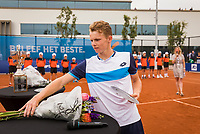 Amstelveen, Netherlands, 1 August 2020, NTC, National Tennis Center, National Tennis Championships, Men's final:  Runner up Jesper de Jong (NED) picks his trophy of the table himself because of Corona mesures<br /> Photo: Henk Koster/tennisimages.com