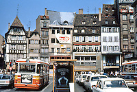 Strasbourg: Old buildings, Main Square, lots of traffic.