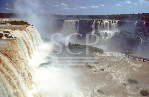 Iguassu, Parana state, Brazil. The Iguassu falls from above with mist rising.