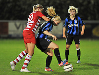 20131001 - VARSENARE , BELGIUM :  Antwerp Sophie Mannaert (left) pictured with Brugge's Jana Coryn (right) during the female soccer match between Club Brugge Vrouwen and Royal Antwerp FC Ladies , of the fifth matchday in the BENELEAGUE competition. Tuesday 1 October 2013. PHOTO DAVID CATRY