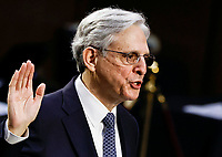 Judge Merrick Garland is sworn in to testify before a Senate Judiciary Committee hearing on his nomination to be U.S. Attorney General on Capitol Hill in Washington, U.S., February 22, 2021.  <br /> Credit: Carlos Barria / Pool via CNP /MediaPunch