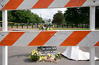 The White House is seen behind a memorial for George Floyd in Washington D.C., U.S., on Thursday, June 11, 2020.  Additional fencing that had been added around the White House due to protests over the death of George Floyd is slowly being removed.  Credit: Stefani Reynolds / CNP/AdMedia