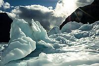 Franz Josef Glacier with its ice formations under dramatic skies, Westland Tai Poutini National Park, UNESCO World Heritage Area, West Coast, New Zealand, NZ