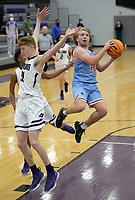 Fort Smith Southside's Jack Williamson (right) flies through the lane Tuesday, Jan. 12, 2021, past Fayetteville's Will Yoakley (left) during the first half of play in Bulldog Arena. Visit nwaonline.com/210113Daily/ for today's photo gallery. <br /> (NWA Democrat-Gazette/Andy Shupe)