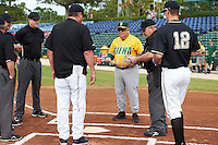 Siena Saints head coach Tony Rossi (40) during the lineup exchange with Pittsburgh Panthers head coach Joe Jordan (jacket) before a game on February 24, 2017 at Historic Dodgertown in Vero Beach, Florida.  Tyler Garbee (12) delivers baseballs to the umpires.  Pittsburgh defeated Siena 8-2.  (Mike Janes/Four Seam Images)