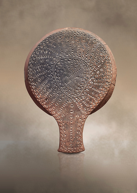 Cycladic terracotta 'frying pan' with incied linear decoration from Chalandriani, Syros. Early Cycladic period II 2800-2300 BC), National Archaeological Museum Athens, Cat No 5012.<br /> <br /> These so called 'frying pans' wre created by the Keros-Syros culture and are their useage is uncertain. The compex geometric patterns on their bases suggest that they may have had some symbolic meaning and were used in religious of magical rituals. They could also have served practical purposes being used as dishes, mirror mounts, astrolabes or metris measured for salt traders.