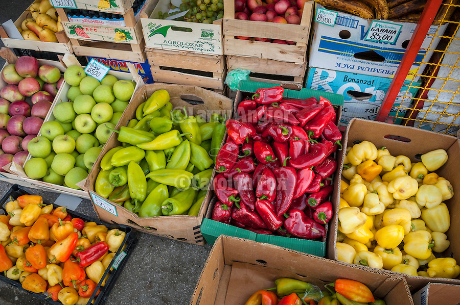 Peppers and apples in boxes at the entrance to a small village store, Kremna, Serbia.