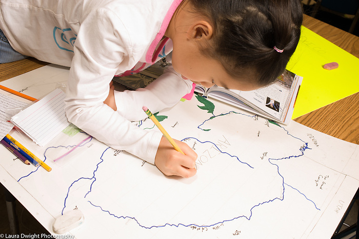 Elementary School Grade 3 girl working on map making project