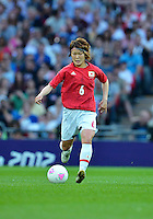 August 09, 2012: Japan's Mizuho Sakaguchi in action during Football Final match at the Wembley Stadium on day thirteen in Wembley, England. USA defeat Japan 2-1 to win it's third consecutive Olympic gold medal in women's soccer. ..