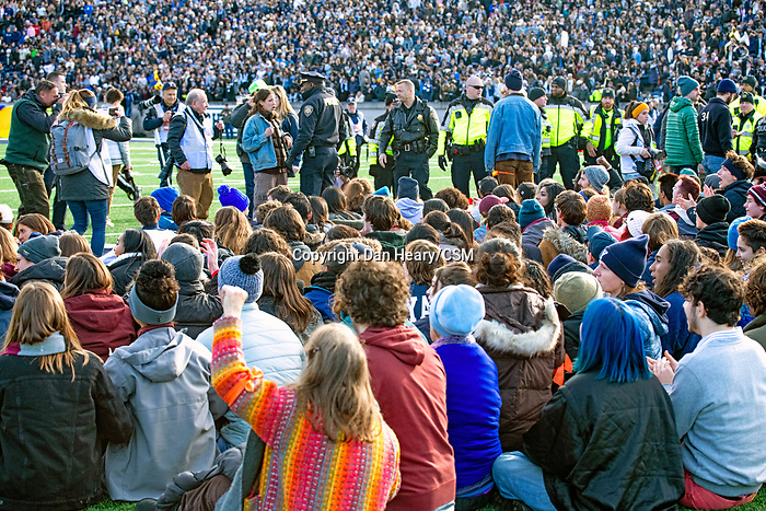 "November 23, 2019: Yale defeated Harvard in double overtime 50-43, in a contest marked by a ""fossil fuel"" protest. It was at halftime of the 136th Ivy League meeting as the ""sit-in"" took place on the 50-yard line at the Yale Bowl in New Haven, Connecticut. Dan Heary/Eclipse Sportswire/CSM"